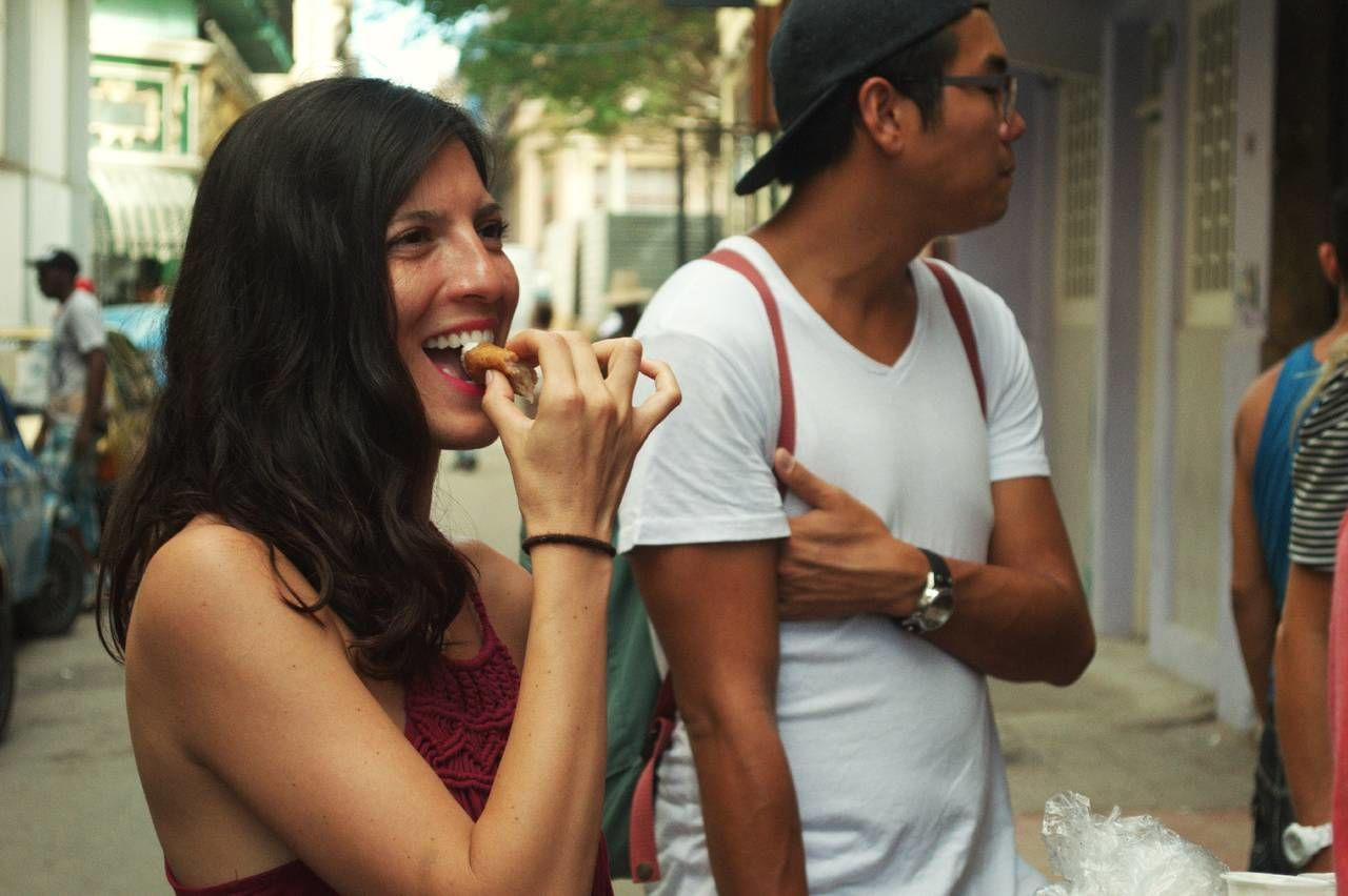 Tourist Eating food in Havana