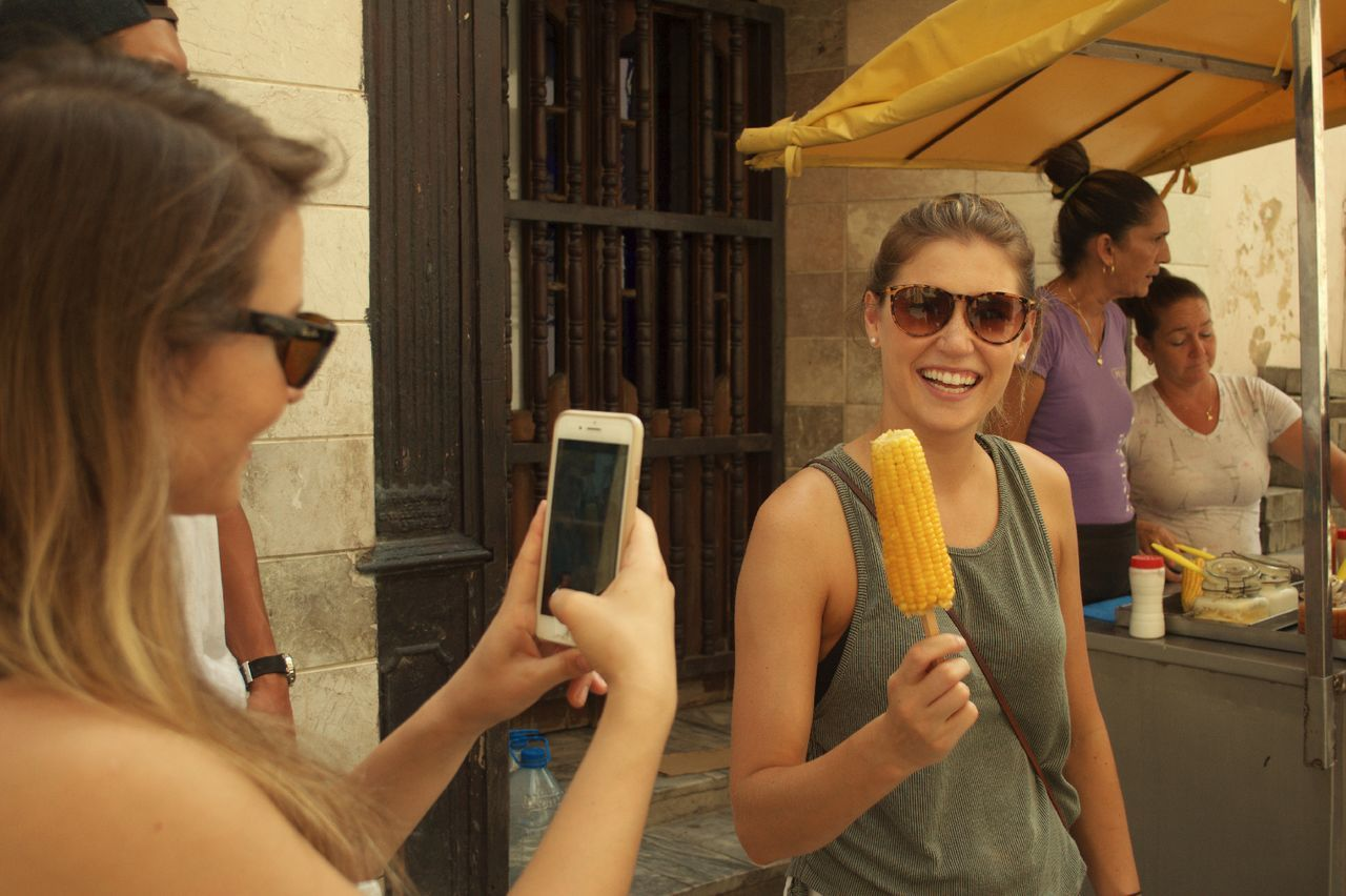 Girls eating Corn in Havana