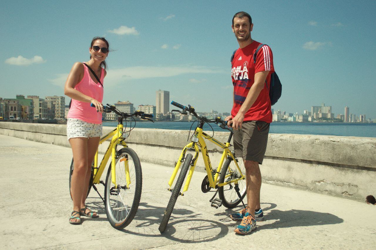 Couple Biking in Havana